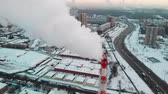 нержавеющий : Aerial view of industrial zone with large red and white pipes with white smoke. Smoke is poured from the factory pipe in contrast to the sun. Pollution of the environment: pipes with smoke.