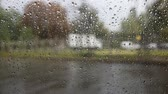 condensed : Rain drops on the glass in the car Stock Footage
