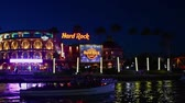 チョコレート : Orlando, Florida. February 05, 2019. Panoramic view of illuminated Hard Rock Cafe and taxi boats on blue night background at Universal Studios area.
