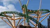 theme : Tampa Bay, Florida. April 30., 2019. Top view of Cheetah Hunt rollercoaster on lightblue cloudy sky background at Busch Gardens. Stock Footage