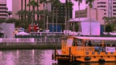 immigrants : Tampa Bay, Florida. March 02, 2019. Water taxi sailing on Hillsborough river on sunset sky background in downtown area.