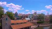 zamek : Orlando, Florida. May 19, 2019. Panoramic view of Cinderella Castle and boardwalk from Steam Boat Liberty Square at Magic Kingdom.