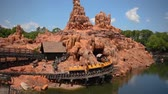 donald duck : Orlando, Florida. May 23, 2019. Panoramic view of people enjoying Big Thunder Mountain Railroad from Steam Boat in Magic Kingdom.