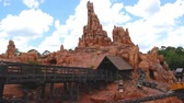conto : Orlando, Florida. May 10, 2019. People enjoying amazing Big Thunder Mountain Railroad on cloudy sky background in Magic Kingdom at Walt Disney World (3)