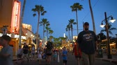 gastronomia : Orlando, Florida. May 26, 2019. People walking on Sunset Boulevard on blue night background at Epcot.
