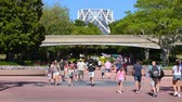 İtalya : Orlando, Florida. May 24, 2019. Time lapse of people walking on Future World West area and Monorail in Epcot at Walt Disney World Resort area. Stok Video