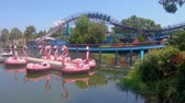 egyetemes : Orlando, Florida. May 27, 2019. Panoramic view of Mako rollercoaster and colorful swam boats at Seaworld Stock mozgókép