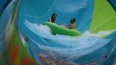 cankurtaran : Orlando, Florida. June 05, 2019. People enjoying curve shaped wave in Karakare Curl attraction at Seaworld 6 Stok Video