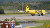 handbag : Orlando, Florida. June 03, 2019. Spirit Airlines plane spinning on the runway at Orlando International Airport. Stock Footage