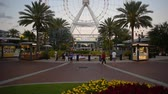 minnie mouse : Orlando, Florida. May 23, 2019. People enjoying Icon Park area and partial view of Orlando Eye at International Drive area. Stock Footage