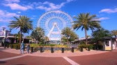 honey moon : Orlando, Florida. May 25, 2019. Timelapse of Orlando Eye on cloudy lightblue sky background in International Drive area. Stock Footage