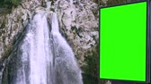 реклама : Billboard green screen near the Fabulous waterfall