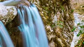 wodospady : Fabulous waterfall in Caucasus mountains. timelapse