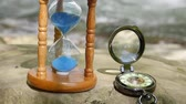geçmiş : Hourglass and pocket watch on the background of a mountain river