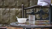 метро : Table and chairs in summer cafe under heavy rain