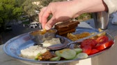 idli : Man eating Indian food dockla and chutney Stock Footage