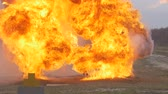 stuntman : Stunt girl in a fiery explosion. Slow motion. Beautiful girl stunt runs across the field through the explosions and fire. Stock Footage
