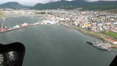 luxo : Port of Ushuaia view from from the top of the helicopter window. Quiet and calm ecotourism. Panorama of way to cold Antarctica.