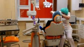 fogorvos : Moscow, Russia - 16 September 2016: Doctor dentist and girl patient in clinic of dentistry. Caries treatment with help of professional medical equipment and instruments. Professional work.