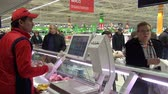 sanitário : Moscow, Russia - 20 May 2016: Woman buys poultry meat and other food products in supermarket.Trade industry. Stock Footage