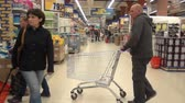 potraviny : Moscow, Russia - 20 May 2016: People in the supermarket. Men and women choose goods. Dostupné videozáznamy