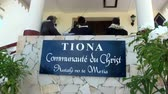 showplace : Tahiti Island French Polynesia - 26 May 2018: People in Church TIONA. Believers sing prayers.