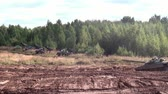 correção : Moscow region, Russia - 27 August 2017: Military BM-21 combat vehicle of the M-21 field reactive system. Tank rides near missile launcher Grad on background of forest.