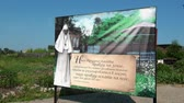 passar : Alapaevsk, Russia - 17 July 2012: Poster with a photo of Elizabeth Feodorovna Romanova near monastery. Museum of Remembrance of Representatives of Russian Imperial House. Stock Footage