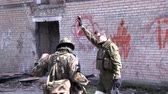 granada : Moscow, Russia - May 09, 2013: Soldiers in military uniform with weapon on background of ruined house. Airsoft game for courageous men in Russia. Stock Footage