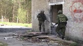 granada : Moscow, Russia - May 09, 2013: Soldiers in military uniform with weapon run on background of ruined house. Airsoft game for courageous men in Russia.