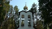 perdition : Alapaevsk, Russia - 17 July 2012: Gilt dome of monasteryof New Martyrs at venue death of Romanov. Building is located on spot where on July 18, 1918 Elizabeth and princes were dumped alive in mine. Stock Footage
