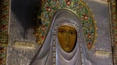 perdition : Alapaevsk, Russia - 17 July 2012: Icon of Saint Elizabeth in monastery of New Martyrs at venue death of Romanov. Religious relic is located in building on site of executions of Elizabeth Feodorovna. Stock Footage
