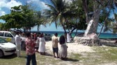 chant : Tahiti Island, French Polynesia - 26 May 2018: People near religious tree with seashells. Stock Footage