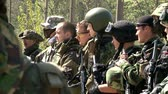 combativo : Moscow, Russia - May 09, 2013: Airsoft team in military uniform with a weapon on background of forest. Sports game using a copy of a firearm.