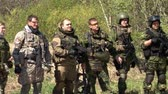 airsoft : Moscow, Russia - May 09, 2013: Airsoft team in military uniform with a weapon on background of forest. Sports game using a copy of a firearm.