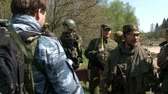 granada : Moscow, Russia - May 09, 2013: Players of airsoft in military uniform with a weapon on background of forest. Sports game using a copy of a firearm.