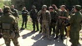 askerler : Moscow, Russia - May 09, 2013: Players of airsoft in military uniform with a weapon on background of forest. Sports game using a copy of a firearm.
