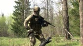 granada : Moscow, Russia - May 09, 2013: Airsoft player is in position in the forest. Sports team game using a copy of a firearm. People in military uniforms with weapons at the exercises.