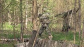 destruído : Moscow, Russia - May 09, 2013: Airsoft game in the forest. People in military uniforms with weapons at the exercises.