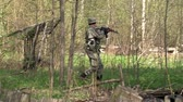 combativo : Moscow, Russia - May 09, 2013: Airsoft game in the forest. People in military uniforms with weapons at the exercises.
