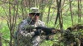 армия : Moscow, Russia - May 09, 2013: Airsoft game in the forest. People in military uniforms with weapons at the exercises.