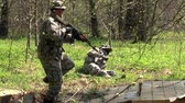 granada : Moscow, Russia - May 09, 2013: Airsoft game in the forest. People in military uniforms with weapons at the exercises.