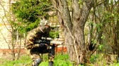 airsoft : Moscow, Russia - May 09, 2013: Men in military uniforms playing in ruined building of airsoft military polygon. People using a copy of a firearm. Stock Footage