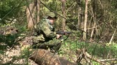 granada : Moscow, Russia - May 09, 2013: Men in military uniforms playing on airsoft military polygon in the forest. People using a copy of a firearm.