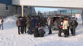 zanedbaný : Chukotka, Russia. - 13 April 2013: People in Airport Anadyr city on far north. Cold snow town on edge of earth.