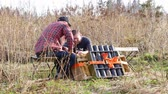 bomba : Moscow, Russia - April 13, 2018: Working people prepare of pyrotechnical equipment for fireworks. Pyrotechnics and explosive material before the celebration.