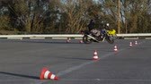 Motorcycle Driving Lessons between traffic cones Moto Gymkhana Motorcyclists