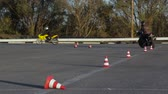 motorcyclists : Motorcycle Driving Lessons between traffic cones Moto Gymkhana Motorcyclists
