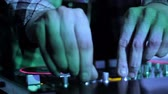 Hands of DJ which mixes music tracks PC mixer in nightclub 6 Stock mozgókép