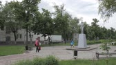 Lipetsk, Russian Federation - May 25, 2016: Monument to Vladimir Lenin on the mall in front of two story building